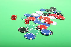 Poker chips. Different color poker chips and dices royalty free stock photography
