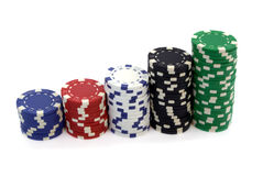 Poker chips. Stacks of poker colorful chips isolated over white Royalty Free Stock Photography