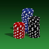 Poker chips. Stacked on a green background Royalty Free Stock Photo