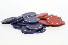Poker chips. Stack of poker chips read and blue on a white background royalty free stock photo