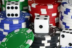 Poker Chips. Stacked gaming chips with dice stock photography