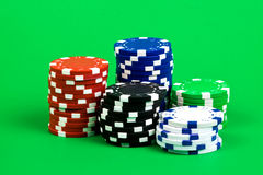 Poker chips. Isolated on green background Royalty Free Stock Photography