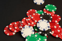 Poker Chips. A pile of colorful poker chips stock images