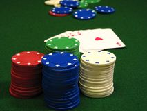Poker chips. And cards with focus on chips in front Stock Photos
