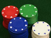 Poker chips. On green felt Stock Photos