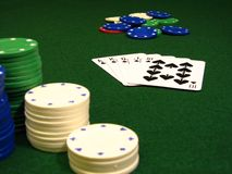 Poker chips. And cards with focus on cards Royalty Free Stock Images
