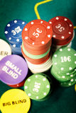 Poker chips. Stack of poker chips on a green table of casino Stock Photos