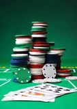 Poker chips. Stacks of poker chips including red, black, white, green and blue Stock Photography