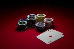 Poker chips and 2 aces Royalty Free Stock Photos