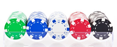 Poker chips. Poker chip set in a glass case Royalty Free Stock Photos