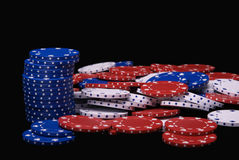 Poker Chips. A pile of poker chips isolated on a black background Stock Images