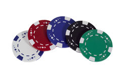 Poker Chips. Row of white, red, blue, green, and black poker chips, isolated royalty free stock photo