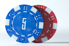 Poker Chips. Two poker chips on a white background Royalty Free Stock Photo