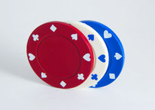 Poker Chips. Red, white and blue poker chips on white background Stock Image