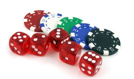 Poker chips and 5 dice Stock Images