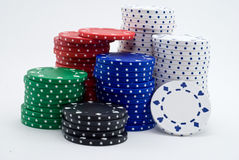 Poker Chips. Stacks of white, red, blue, green, and black poker chips on a white background Stock Photography