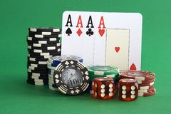 Poker chips. Stack of poker chips with cards and dice Royalty Free Stock Photography
