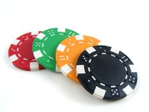 Poker chips. A set of four colorful poker chips royalty free stock photography