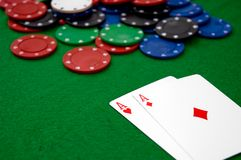 Poker chips and AA Royalty Free Stock Photo