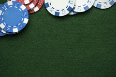 Poker chips Baize cloth table top Royalty Free Stock Photos