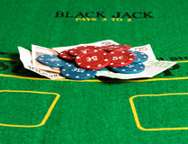 Poker chips and bills. Royalty Free Stock Photography
