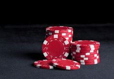 Poker chips on black Royalty Free Stock Photos