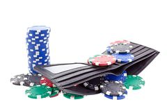 Poker chips in black leather purse Royalty Free Stock Image