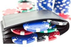 Poker chips in black leather purse Stock Photos