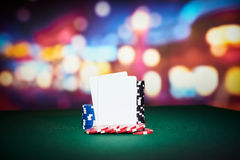 Poker chips with blank cards. On table in casino Stock Images
