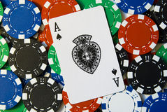 Poker Chips and card Ace. Lots of poker chips and a ace card on top Royalty Free Stock Images