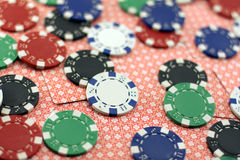 Poker chips on the cards Royalty Free Stock Images