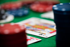 Poker chips and cards. A few poker chips and a good hand on a green underground Royalty Free Stock Images