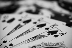 Poker chips and cards. Royal Flush hand laying on withe and black poker chips Stock Image