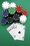 Poker chips and cards. In a royal flush ready to play royalty free stock images