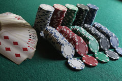 Poker chips and cards on the cloth Stock Photos