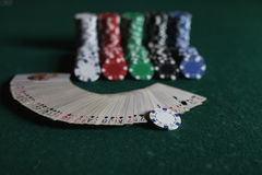Poker chips and cards on the cloth Stock Images