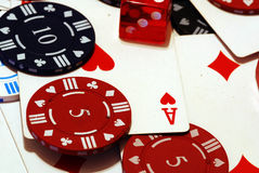 Poker Chips Cards and Dice. A lfullscreen of poker chips some cards and a dice Royalty Free Stock Images