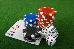 Poker chips,cards and dices Stock Photos