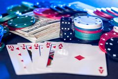 Poker chips, cards, dollars and bones Stock Images