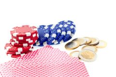 Poker chips, cards and euro coins Stock Image
