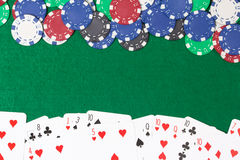 Poker chips and cards on a green table background Royalty Free Stock Photos