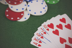 Poker chips and cards on a green table Royalty Free Stock Photos