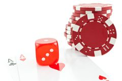 Poker chips, cards and red dice cube Stock Photo