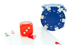 Poker chips, cards and red dice cube isolated Royalty Free Stock Photography