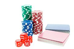 Poker chips, cards and red dice cubes Stock Photos