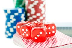 Poker chips, cards and red dice cubes Stock Photo