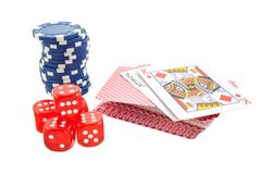 Poker chips, cards and red dice cubes isolated Royalty Free Stock Photo