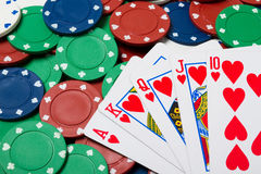 Poker chips and cards - royal flush Royalty Free Stock Photography