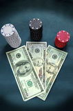 Poker chips and cash Royalty Free Stock Images