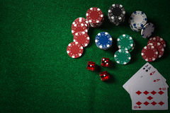 Poker Chips on casino gamble green table, dark tone. stock photo